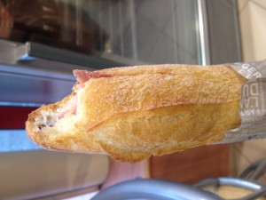 "A sanwich ""jambon fromage,"" which consists of ham, cheese and butter on a fresh baguette"
