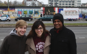 Megan (center) and former UCWbLer, Jake P (right), marveled at the East Gallery of the remaining Berlin Wall.