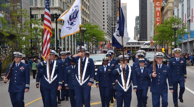 Members of the Coast Guard and Coast Guard Auxiliary march down Chicago's State Street during this year's Memorial Day Parade, May 25, 2013. Rear Adm. Michael Parks, commander, 9th Coast Guard District, also participated by joining former Secretary of Defense Leon Panetta, Chicago Mayor Rahm Emanuel and leaders of the other service branches at the start of the parade, considered one of the largest in the nation. (Coast Guard photo by Chief Petty Officer Alan Haraf)